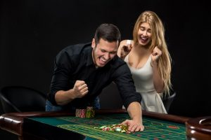 playing roulette girl and boy