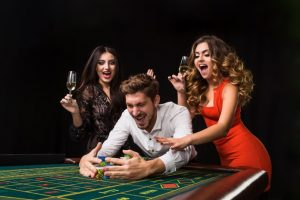 playing roulette girls and man