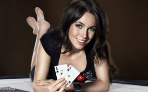 pretty casino girl playing poker