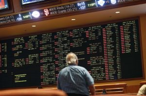 Sports bets on a big board